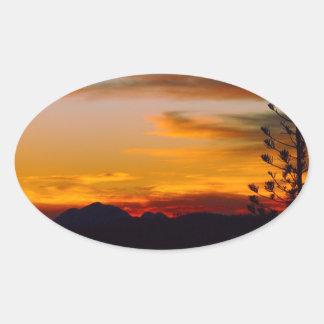 Autocollant d'ovale de coucher du soleil de