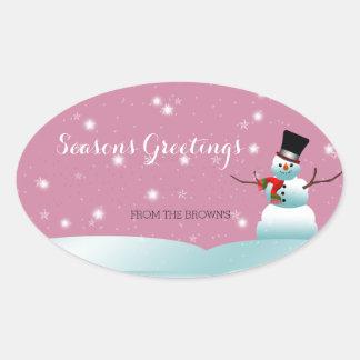 Autocollant heureux d'ovale d'hiver de Noël de