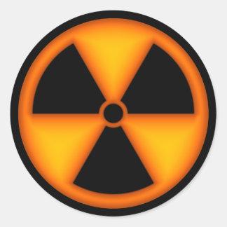 Autocollant orange de symbole de rayonnement