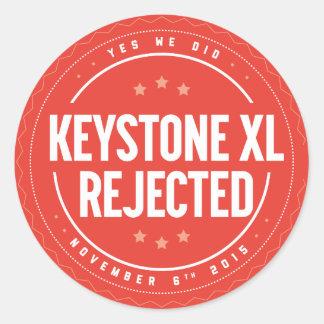 Autocollant rejeté par XL de clef de voûte