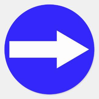 Autocollant rond avec la flèche sur la droite