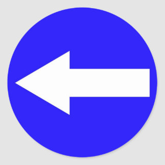 Autocollant rond avec la flèche vers la gauche