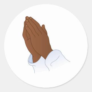 Autocollant rond de main de prière