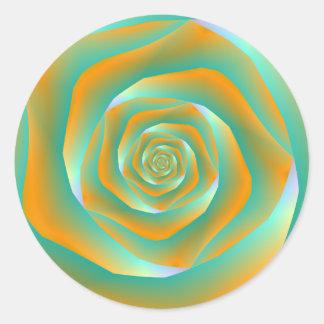 Autocollant rond de rose orange et vert de spirale
