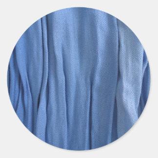 Autocollant rond de tissu bleu