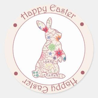 Autocollant rond heureux de Pâques avec le lapin