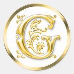 Autocollant rond initial de G en or