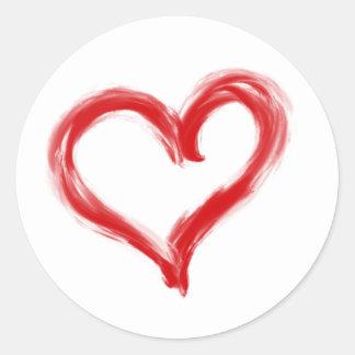 Autocollant rouge de coeur peint par brosse