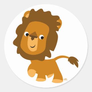 Autocollant satisfait de lion de bande dessinée