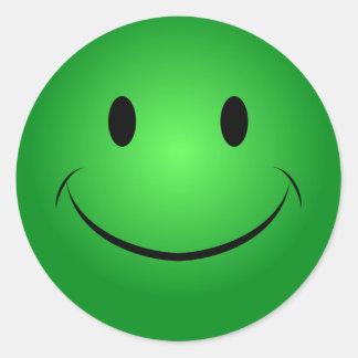 Autocollant souriant vert
