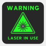 Autocollant vert et noir de signe d'alerte laser