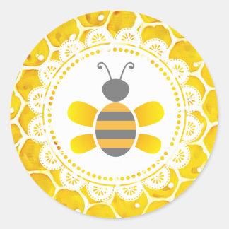 Autocollants noirs et jaunes de nid d'abeilles