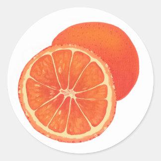 Autocollants oranges entiers et découpés en