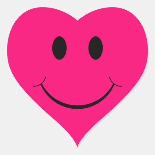 Autocollants souriants de visage de coeur rose