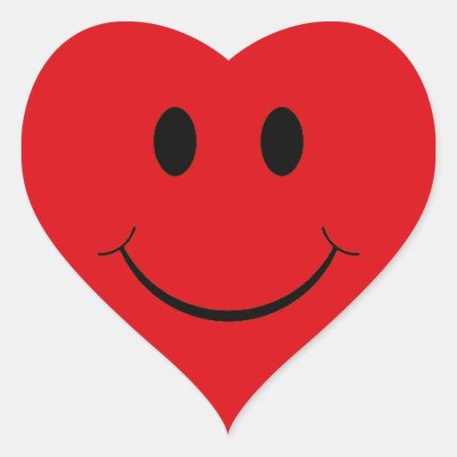 Autocollants souriants de visage de coeur rouge