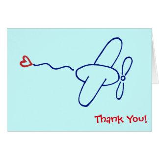 Avion de bleu marine avec la note rouge de Merci Cartes De Vœux