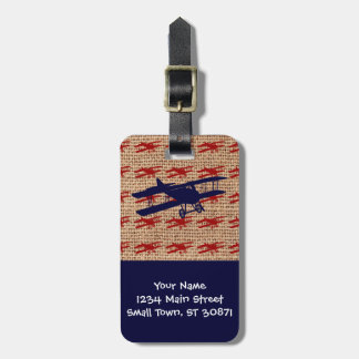 Avion vintage de propulseur de biplan sur la copie étiquettes bagages