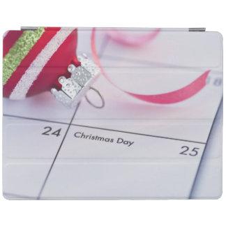 Babiole de Noël sur le calendrier Protection iPad