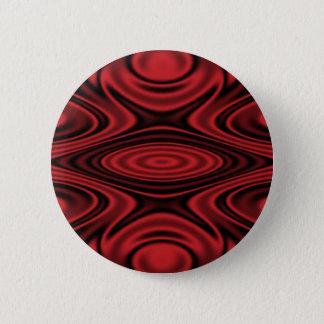 Badge Anneaux et ondulations rouges
