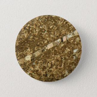 Badge Chaux sous le microscope