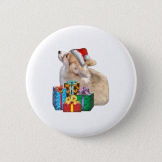 Badge Chiot de corgi de Gallois avec le casquette de