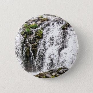 Badge chute de roches au cours des chutes