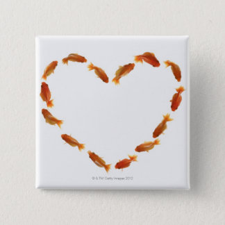 Badge Coeur fait avec des poissons rouges
