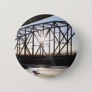 Badge Coucher du soleil derrière le pont à Palmer Alaska