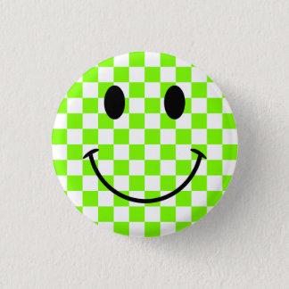 Badge Damier Chartreuse et visage souriant noir