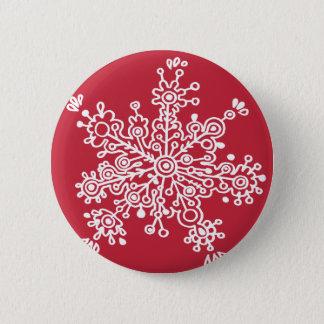 Badge Flocon de neige sur le rouge
