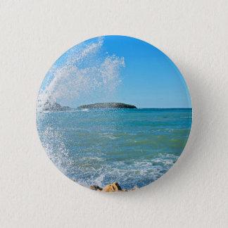 Badge Grande vague sur la mer bleue