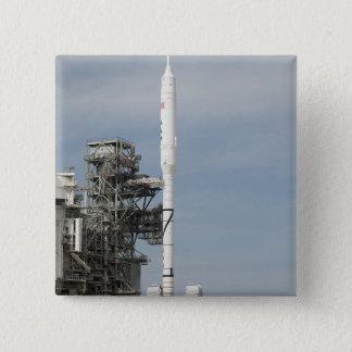 Badge La fusée d'Ares IX est vue sur la plate-forme de