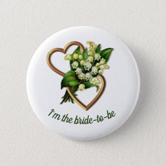 Badge Le muguet avec la jeune mariée de deux coeurs à
