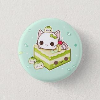 Badge Minou mignon de mochi avec le gâteau de thé vert