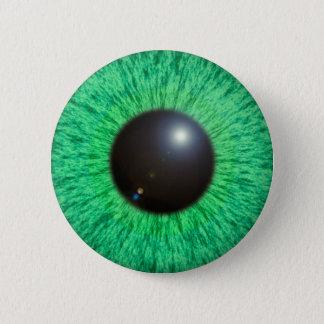 Badge Oeil vert-bleu avec le bouton de fusée