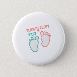 Badge Rond 5 Cm Le genre sain de bébé d'équipe indiquent le rose