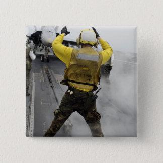 Badge Un directeur d'avions signale un frelon de F/A-18C