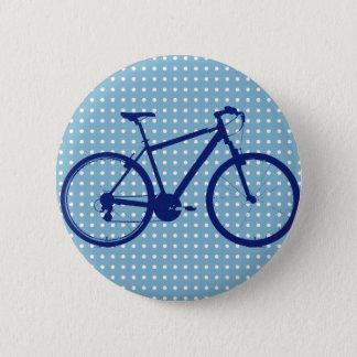 Badge vélo et pois bleus