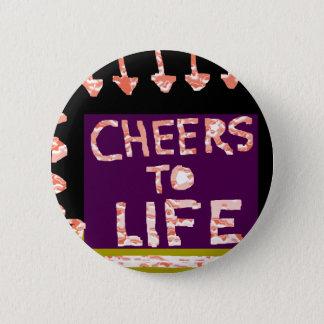 Badges Acclamations à la vie - l'artiste a ouvré des