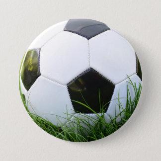 Badges Ballon de football dans l'herbe d'été