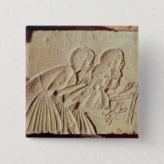 Badges Comprimé dépeignant quatre scribes au travail