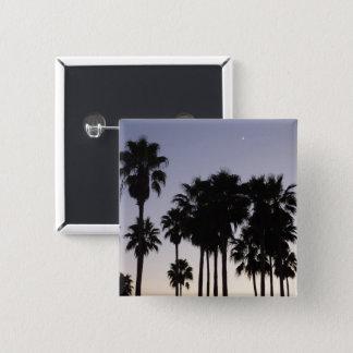 Badges Crépuscule avec la scène tropicale de palmiers