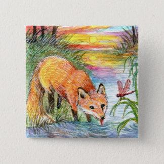 Badges Fox buvant par la rive