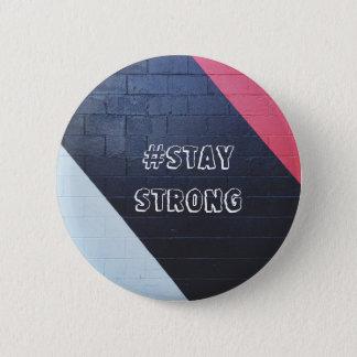Badges géométrique abstrait de rouge et de noir/séjour