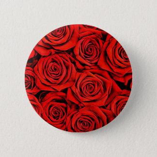 Badges La fleur florale de pétales de roses rouges plante