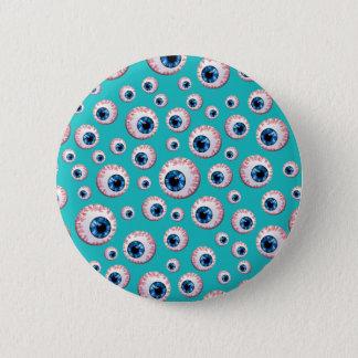 Badges Motif de globe oculaire de turquoise