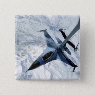 Badges Un agresseur F-16 repose en contact la position