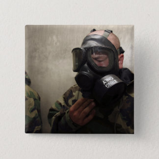 Badges Un opérateur radio de champ dégage le gaz de CS