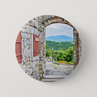 Badges Ville de vue de porte et de rue de pierre de