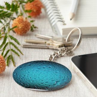 Baisses fraîches élégantes de l'eau bleue porte-clé rond